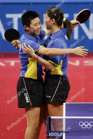 Guo Yue and Niu Jianfeng of China Celebrate After Winning the Bronze Medal in the Women's Doubles Table Tennis Competition at the Athens Olympic Games Friday 20 August 2004 Wang Nan and Zhang Yining of China Won the Gold Medal Lee Sun Sil and Seok Eun Mi of Korea Won Silver Epa Vasilis Ververidis