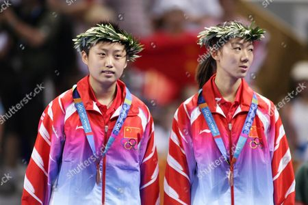 Guo Yue and Niu Jianfeng of China Pose On the Podium of the Women's Doubles Table Tennis at the Athens Olympic Games Friday 20 August 2004 China's Wang Nan and Zhang Yining Won the Gold Medal Korea's Lee Sun Sil and Seok Eun Mi the Silver Guo Yue and Niu Jianfeng Won the Bronze Medal Epa Vasilis Ververidis