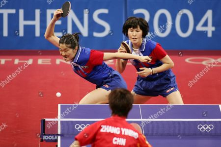 Guo Yue and Niu Jianfeng (rear) of China Compete with Kim Bok Rae and Kim Kyung Ah of Korea During Their Bronze Medal Match of the Women's Doubles Table Tennis at the Athens Olympic Games Friday 20 August 2004 China's Wng Nan and Zhang Yining Won the Gold Medal Korea's Leesun Sil and Seok Eun Mi the Silver Guo Yue and Niu Jianfeng Won the Bronze Medal Epa Vasilis Ververidis