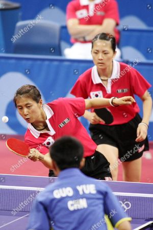 Kim Bok Rae and Kim Kyung Ah of Korea (rear) Compete with Guo Yue and Niu Jianfeng of China During Their Bronze Medal Match of the Women's Doubles Table Tennis at the Athens Olympic Games Friday 20 August 2004 China's Wang Nan and Zhang Yining Won the Gold Medal Korea's Lee Sun Sil and Seok Eun Mi the Silver Guo Yue and Niu Jianfeng Won the Bronze Medal Epa Vasilis Ververidis