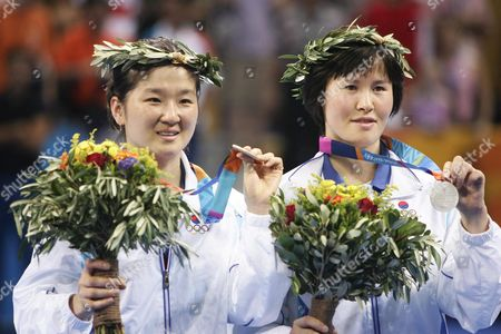 Lee Sun Sil and Seok Eun Mi of Korea Hold Their Silver Medals On the Podium of the Women's Doubles Table Tennis at the Athens Olympic Games Friday 20 August 2004 Wang China's Nan and Zhang Yining Won the Gold Medal Guo Yue and Niu Jianfeng of China Won the Bronze Medal Epa Vasilis Ververidis