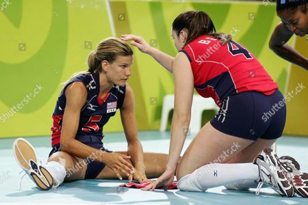 Us Player Stacy Sykora (l) is Comforted by Teammate Lindsey Berg After the Women's Volleyball Quarter-final Match Brazil Vs Usa of the Athens 2004 Olympic Games Tuesday 24 August 2004 Brazil Won 3-2 Epa Vassilis Ververidis