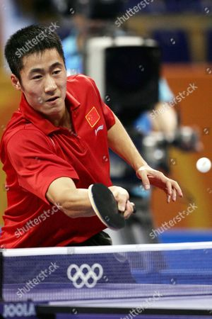 China's Wang Liqin Returns the Ball to Jan-ove Waldner of Sweden During the Mens's Singles Table Tennis Bronze Medal Match of the Athens 2004 Olympic Games at the Galatsi Olympic Hall in Athens Monday 23 August 2004 Wang Liqin Won 4-1 Epa Vassils Ververidis