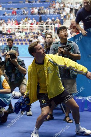 Jan-ove Waldner of Sweden Throws His Jersey to Supporters in the Stands After the Mens's Singles Table Tennis Bronze Medal Match of the Athens 2004 Olympic Games at the Galatsi Olympic Hall in Athens Monday 23 August 2004 Wang Liqin Won 4-1 Epa Vassils Ververidis