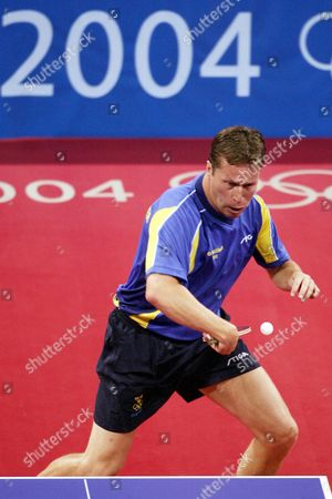 Jan-ove Waldner of Sweden Hits a Return to China's Wang Liqin During the Mens's Singles Table Tennis Bronze Medal Match of the Athens 2004 Olympic Games at the Galatsi Olympic Hall in Athens Monday 23 August 2004 Wang Liqin Won 4-1 Epa Vassils Ververidis