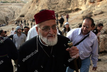Gregory Iii Laham Patriarch of the Church of Antioc Climbs the Maloula Mountain On the Road of Jesus Christ to Celebrate the Holy Cross Day in Maloula Some 60 Km Northwestern Damascus Syria 13 September 2009 Christians Make Up Some 13 Percent of Syrias 20 Million Population