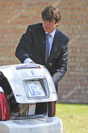Indicted Former Illinois Governor Rod Blagojevich Closes the Trunk of a Car As He Leaves Funeral Services For Christopher Kelly Blagojevich's Former Adviser and Fundraiser in Western Springs Illinois Usa 16 September 2009 Kelly Who Pled Guilty to Federal Charges not Related to Blagojevich and Was to Report to Prison 18 September Committed Suicide 12 September Reportedly Under Pressure From Authorities to Testify Against Blagojevich