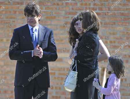 Indicted Former Illinois Governor Rod Blagojevich (l) Stands with Daughter Amy (2-l) Wife Patty (2-r) and Daughter Annie (r) As They Leave Funeral Services For Christopher Kelly Blagojevich's Former Adviser and Fundraiser in Western Springs Illinois Usa 16 September 2009 Kelly Who Pled Guilty to Federal Charges not Related to Blagojevich and Was to Report to Prison 18 September Committed Suicide 12 September Reportedly Under Pressure From Authorities to Testify Against Blagojevich