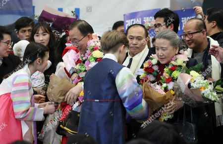 Former U.N. Secretary-General Ban Ki-moon and his wife Yoo Soon-taek receive bouquets of flowers after arrived at Incheon International Airport in Incheon, South Korea, . The former U.N. Secretary-General has returned to native South Korea amid widespread expectations he'll run for president