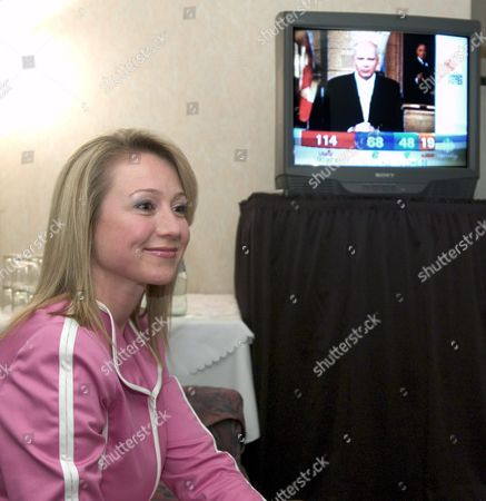 Canadian Conservative Candidate Belinda Stronach Watches Federal Election Returns On Television While Waiting For Her Results in Her Home Riding of Newmarket-aurora in Aurora Canada Monday 28 June 2004 Stronach Quit Her Job As Chief Executive Officer of Magna International to Enter Politics Aurora is 30 Km North of Toronto