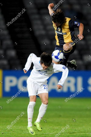 Central Coast Mariners Andrew Clark (right) Towers Over Ma Leilei of the Chinese Team Tianjin Teda As They Contest a Header During Their Afc Champions League Match in Gosford Australia 19 May 2009 Tianjin Won the Match 1-0