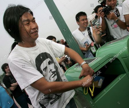Maverick Law-maker Leung Kwok-hung Otherwise Know As 'Long Hair' Throws His Pass For the Disney Grand Opening Into the Trash Hong Kong Disneyland Park Monday 12 September 2005 the Hong Kong Lawmaker Was Protesting Against Disney's Alleged Labour Abuses in Mainland China Monday's Opening Ceremony Included Dignitaries From Hong Kong China and the Walt Disney Company Including Michael D Eisner Walt Disney Company Ceo; Robert a Iger Walt Disney Company President Chief Operating Officer and Ceo-elect; Zeng Qinghong Vice-president of the People's Republic of China; and Donald Tsang Chief Executive of the Government of the Hong Kong Special Administrative Region