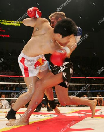 Stock Image of South Korea's 'Kwak Yun-suh' (l) Also Known As 'Chong-ho' 29 Prepares to Take a Fall As Nathan Corbett (r) 36 From Australia Trips Up the Korean in the 'Imf Light Heavyweight World Title - 86kg' Title Fight Held in Hong Kong's Queen Elizabeth Stadium Hong Kong Friday 09 September 2005 Corbett Went On to Win the Fight and the Title