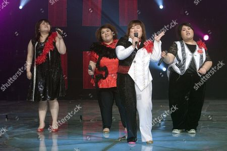 (l-r) Zhang Wen Yang Ye Shen Jing and Xiao Yang of the Band 'Qian Jin' (500 Kg) Perform During a Tv Show in Beijing On 11 May 2007 the Band's Name is an Allusion to the Combined Weight of the Four Overweight Members Xiao Yang Born with Lipometabolic Disorder Founded the Band in 2006 After She Failed to Find an Adequate Job Despite Having Graduated As the Best in Her Class to Encourage Overweight People to Feel More Comfortable