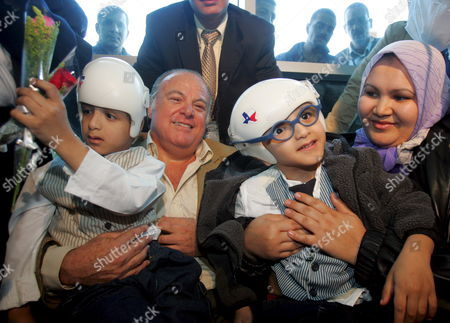 Mohamed (l) and Ahmed Ibrahim (r) with Their Mother Sabah Abu El-wafa and Dr Nasr Abel Al (c) Upon Arrival to Cairo International Airport Sunday 20 November 2005 the Formerly Conjoined Twins Were Arriving Home to Egypt After Receiving Extensive Surgery to Separate Them in the United States