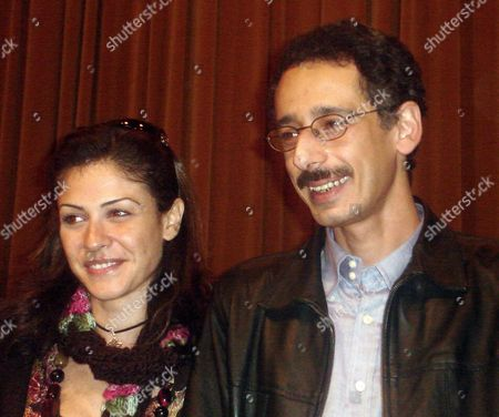 Egyptian Actress Basma (l) and Egyptian Director Mohamed Amin Pose For Photographers Thursday 08 December 2005 During a Press Conference About Their New Movie 'Lailat Seqout Baghdad' (the Night of Baghdad's Fall' with Egyptian Actors Hassan Hosney and Hala Fakher the Movie is the Only Arabic Movie Which Competed in the Cairo Film Festival