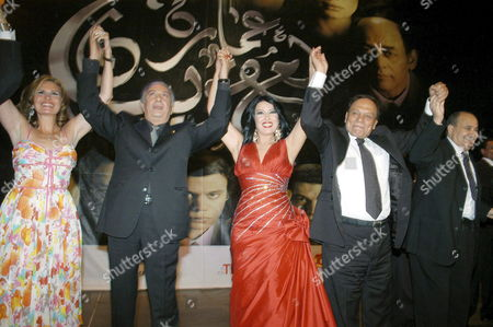 The Cast of the Egyptian Film 'Amaret Yacoubian' (yacoubian Building) Pose For a Picture at the Official Premiere of the Film at Cairo's Opera House Late 19 June 2006 the Best-selling Book by Author Alaa Al Aswany Follows the Lives of Residents Both Rich and Poor of an Actual Apartment Building in Downtown Cairo the Star-studded Movie Cast and Reported 22 Million Egyptian Pounds (4 Million Usd - 3 2 Million Euros) Budget Deals with Controversial Uncomfortable and Often Taboo Subjects About the Secular World of a Modern Islamic Country Many of the Famouse Actors Share This Movie Adel Imam Yousra Nour Al Sherief Hend Sabri Khaled Saleh Khaled Zaki and Isaad Younis the Movie Will Be Screen in Theaters From Wednesday 21 June 2006