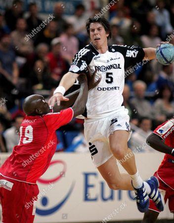 K Andersson (r) of Kiel in Action Against Olivier Girault (l) of Paris Handball During Their Handball Champions League Match in Paris Sunday 04 December 2005