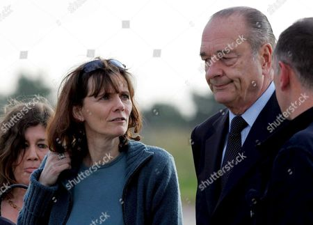 President of France Jacques Chirac (r) Welcomes French Journalist Florence Aubenas (l) at Paris' Military Airport Villacoublay Sunday 12 June 2005 After Her Return From Iraq where She Had Been Held Hostage For Five Months Florence Aubenas and Her Iraqi Guide Hussein Hanoun Al-saddi Were Freed Yesterday in Iraq and Flown to Cyprus Today