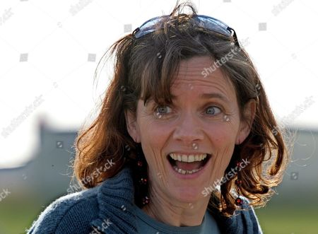 French Journalist Florence Aubenas is All Smiles Upon Her Arrival at Paris' Military Airport Villacoublay Sunday 12 June 2005 After Her Return From Iraq where She Had Been Held Hostage For Five Months Florence Aubenas and Her Iraqi Guide Hussein Hanoun Al-saddi Were Freed Yesterday in Iraq and Flown to Cyprus Today