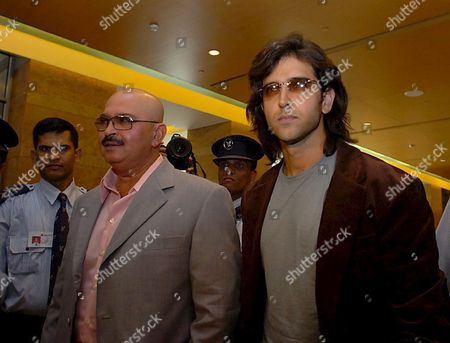 Indian Actor Hritik Roshan (r) and His Father Rakesh Roshan Arrive For a Press Conference in Mumbai 06 July 2005 the Senior Roshan is Planning to Film Almost 60 Percent of His New Film 'Krrish' Which Features His Son Hritik and is a Sequel to His Hit - the 2003 Science-fiction Film 'Koi Mil Gaya' (someone Found) a Take-off of Steven Spielberg's 'E T ' in Singapore