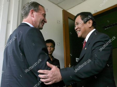 Stock Photo of Indonesian Coordinating Minister For Political Legal and Security Affairs Widodo As (r) Talks to Dutch Minister of Defense Henricus Grogorius Joseph During Their Meeting in Jakarta Indonesia Wednesday 18 May 2005 Joseph Visits to Indonesia to Talk About Military Cooperation Between Both Countries