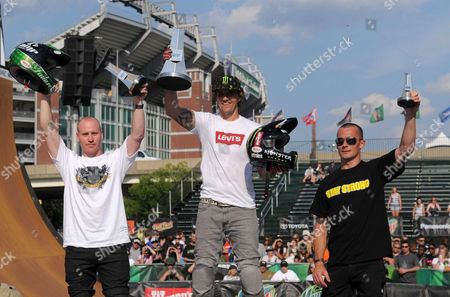 Chad Cagy (left) finishes second, Simon Tabron (right) finishes third, and Jamie Bestwick earns his second consecutive BMX vert championship