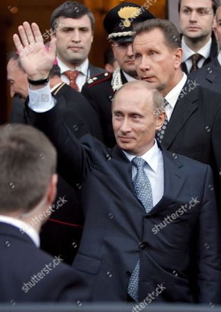 Stock Image of Russian President Vladimir Putin Gestures During His Visits the Basilica of San Nicola a Church That is Reputed to Hold the Remains of Saint Nicholas a Saint Who is Deeply Revered by Catholic and Russian Orthodox Believers Alike in the Southern Italian City of Bari Wednesday 14 March 2007 Italy and Russia Held a Bilateral Summit in Bari with Energy and Defence Deals High On the Agenda of Prime Minister Romano Prodi and President Vladimir Putin