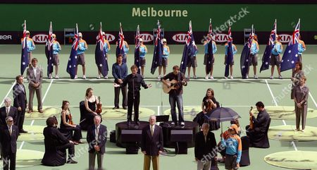 Australia's Greatest Tennis Players Stand in a Square On Central Court in the Rod Laver Arena in a Ceremony Celebrating the Centenary 1905 - 2005 of the Australian Open On Australia Day at the Australian Open Tennis at Melbourne Park Australia Wednesday 26 January 2005 the Legends of Australian Tennis Included Evonne Goolagong Cawley R Back Margaret Court R Fron Len Schwartz Front Under Umbrella Frank Sedgman Ken Rosewell Roy Emerson John Newcombe Pat Cash L at Back and Pat Rafter Second From L at Back Australian Tenor Peter Brocklehurst Sings in the Middle