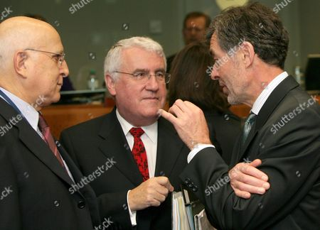 (l-r) Stavros Dimas Member of the European Commission Dick Roche Irish Minister For Environment and Jan-erik Enestam Finnish Minister For Environment Talks Prior to a European Environment Council at the Eu Headquarters in Brussels Thursday 09 March 2006 the Ministers Discuss the Controversial Topic of Genetically Modified Organisms (gmos) On European Food Markets Climate Change and the Kyoto Protocol