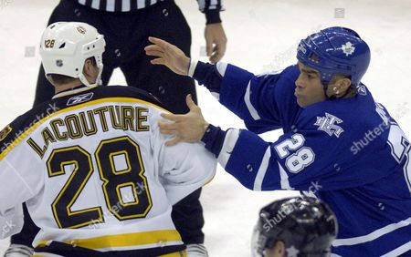 Boston Bruins' Dan Lacouture (l) Fights with Toronto Maple Leafs' Tie Domi During the First Period of Their Nhl Hockey Game at the Air Canada Centre in Toronto Canada On Tuesday 14 March 2006 Both Received Five Minute Penalties