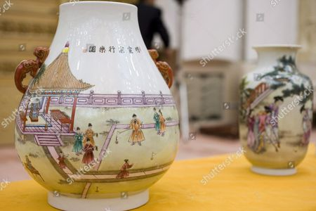 Reproduction Porcelain Vases Decorated with Paintings Of'chuiwan' Or 'Strike Ball' Are Unveiled at a Press Conference by Chinese State Sports Officials in Beijing's Great Hall of the People Who Claim It is the Original Form of Golf Wednesday 26 April 2006 the Claim is Based Upon a Series of Books and Paintings Dating Back to the Yuan Dynasty (13th Century Ad) Which Show Members of the Imperial Court Enjoying an 'Elegant Sport' Involving Clubs of Carved Precious Woods and Balls of Wood and Jade That Were Struck Into Holes Much Like Modern Golf Whether the Scottish Form of the Game Has Any Relation to This Find Beyond Coincidence Remains to Be Proved