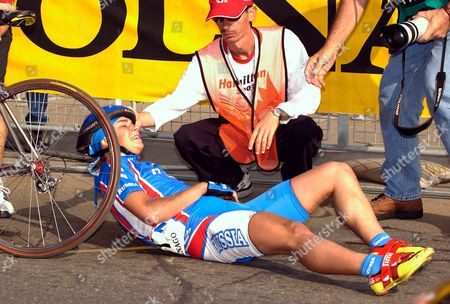 Russian Cyclist Irina Tolmacheva is Helped by a Race Official After She Collided with a Photographer Just After She Crossed the Finish Line at the Junior Women's Individual Road Race at the 2003 Road World Championships in Hamilton Canada On 10 October 2003 Tolmacheva Suffered Cuts to Her Chin and Was Able to Collect Her Silver Medal