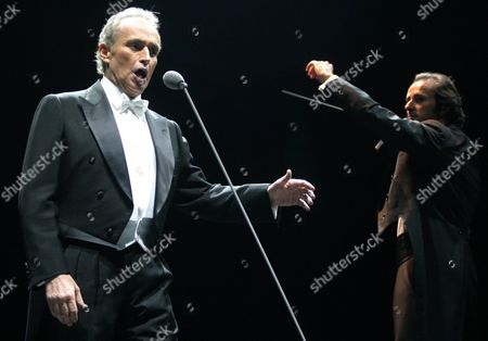 Stock Image of Spanish Tenor Jose Carreras Performs with Conductor David Gimenez and the Hong Kong Philharmonic Orchestra at the Hong Kong Harbour Festival Monday 20 October 2003