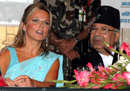 British Singer Geri Halliwell Talks with Nepal's Prime Minister Madhav Kumar Nepal at a Function Organized by the United Nations Population Fund (unfpa) in Kathmandu Nepal 09 September 2009 Halliwell a Goodwill Ambassador of the Unfpa is in Nepal For a Four Days Visit to Highlight the Consequences of Maternal Death and Injuries Such As Uterine Prolapsed in the Country