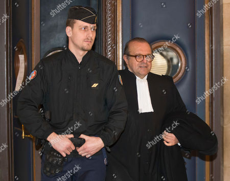 Herve Temime, right, the lawyer of Guy Wildenstein, a 71-year-old Franco-American art dealer, leaves the court room at Paris court house in Paris, . A French judge has cleared international art dealer Guy Wildenstein of hiding valuable paintings to dodge paying tax