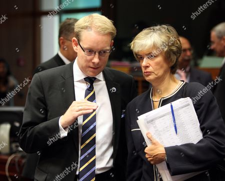 Swedish Migration Minister Tobias Billstrom (l) Chats with Finnish Minister of Migration and European Affairs Astrid Thors at the Start of the European Interior Minister Council in Brussels Belgium 21 September 2008 Interior Ministers Are Expected to Discuss Recent Proposals by the European Commission to Expand Refugee Settlement Across the Bloc the Proposals Suggest That an Expert Group Should Examine Annual Eu Resettlement Priorities Looking at Geographic Nationality and Types of Refugees