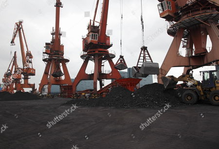 Large Mechanical Scoops Carry Coal Onto Barges in Shanghai China on 08 September 2009 China the Biggest Producer of Coal Gets About 80 Per Cent of Its Electricity From Burning the Fuel Which Spews More Heat- Trapping Gases Than Natural Gas Or Oil China Has a 'Critical' Role in Developing Clean-energy Technologies Such As Carbon Capture Nobuo Tanaka Executive Director of the International Energy Agency Said in Beijing Earlier This Year China Shanghai