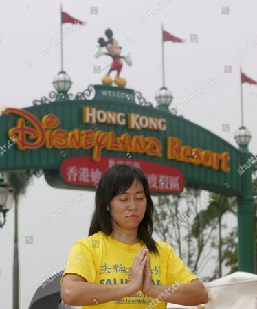 A Falun Gong Practitioner at Hong Kong Disneyland Park Monday 12 September Hong Kong the Religious Group That is Banned On Mainland China Took the Opportunity to Let Their Voice Be Heard at the Disney Resort As Senior Mainland Officials Were Present For the Grand Opening Monday's Opening Ceremony Included Dignitaries From Hong Kong China and the Walt Disney Company Including Michael D Eisner Walt Disney Company Ceo; Robert a Iger Walt Disney Company President Chief Operating Officer and Ceo-elect; Zeng Qinghong Vice-president of the People's Republic of China; and Donald Tsang Chief Executive of the Government of the Hong Kong Special Administrative Region