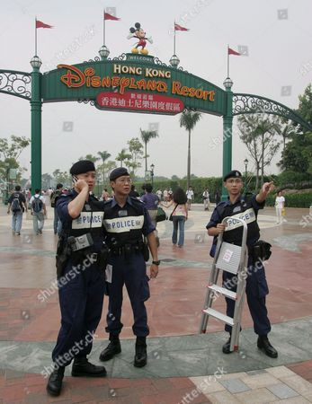 Police Coordinate the Surveillance of Various Protest Groups at the Hong Kong Disneyland Park Monday 12 September 2005 Monday's Opening Ceremony Included Dignitaries From Hong Kong China and the Walt Disney Company Including Michael D Eisner Walt Disney Company Ceo; Robert a Iger Walt Disney Company President Chief Operating Officer and Ceo-elect; Zeng Qinghong Vice-president of the People's Republic of China; and Donald Tsang Chief Executive of the Government of the Hong Kong Special Administrative Region