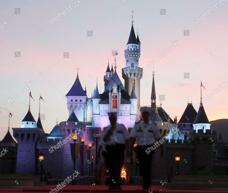 Security Guards in Front of Sleeping Beauty's Castle at Hong Kong Disneyland Monday 12 September Monday's Grand Opening Ceremony Included Dignitaries From Hong Kong China and the Walt Disney Company Including Michael D Eisner Walt Disney Company Ceo; Robert a Iger Walt Disney Company President Chief Operating Officer and Ceo-elect; Zeng Qinghong Vice-president of the People's Republic of China; and Donald Tsang Chief Executive of the Government of the Hong Kong Special Administrative Region