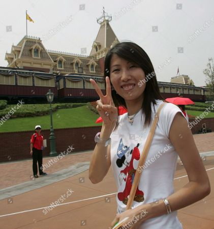 A Tourist Shows Her Delight at Hong Kong Disneyland Park Monday 12 September Hong Kong Monday's Opening Ceremony Included Dignitaries From Hong Kong China and the Walt Disney Company Including Michael D Eisner Walt Disney Company Ceo; Robert a Iger Walt Disney Company President Chief Operating Officer and Ceo-elect; Zeng Qinghong Vice-president of the People's Republic of China; and Donald Tsang Chief Executive of the Government of the Hong Kong Special Administrative Region