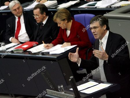 (f L to R): the Chairman of the German Fdp Liberal Party Faction Wolfgang Gerhardt Holds a Speech Standing Beside German Chancellor Angela Merkel Vice-chancellor Franz Muentefering and Federal Foreign Minister Frank-walter Steinmeier During a German Bundestag Budget Debate in Berlin Germany Wednesday 29 March 2006