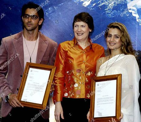 New Zealand Prime Minister Helen Clark Center and Bollywood Actors Hritik Roshan Left and Amisha Patel Right Pose For the Photographers After Clark Presented Them Mementos in Bombay India Monday Oct 18 2004 Roshan and Patel Were the Famous Star of Many Films Was Filmed in New Zealand
