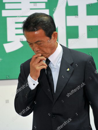 Japanese Prime Minister Taro Aso Gestures As Leaves His Last News Conference As President of the Ruling Liberal Democratic Party (ldp) at Party's Headquarters in Tokyo Japan 31 August 2009 Following the Historical Defeat in the Lower House Elections the Ruling Ldp Lost Power For Only the Second Time Since 1955 and Opposition Democratic Party of Japan (dpj) Led by Yukio Hatoyama Won a Landslide Victory in the General Election Japan Tokyo