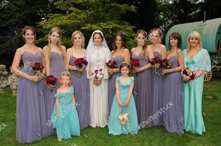 Leah Wood (4th l) with bridesmaids (from left) Lola Kirke, Theodora Richards, Georgia May Jagger, Domino Kirke, Jemima Kirke, Alexandra Richards, Kirsty Taylor and maid of honour Amanda Harrington, and flower girls (front row) Kitty and Mercy Magic