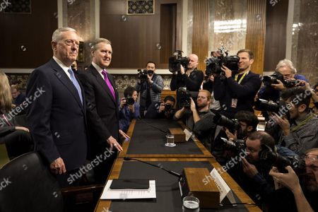 Retired United States Marine Corps general  and Donald Trump's nominee for Secretary of Defense James Mattis (L), stands next to former Secretary of Defense William Cohen (C), as Mattis waits to testify at his confirmation hearing before the Senate Armed Services Committee in the Dirksen Senate Office Building