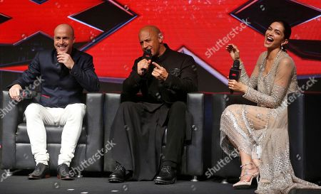 Hollywood actor Vin Diesel, center, speaks with co-star Deepika Padukone, right, and director D. J. Caruso seated beside him during a press conference to promote their film XXX: Return of Xander Cage in Mumbai, India