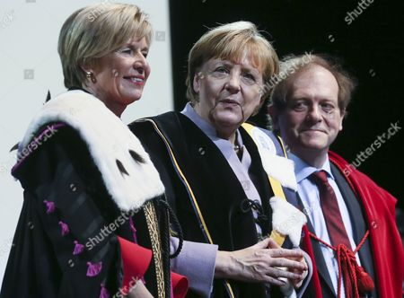 (L-R) Professor Anne De Paepe, rector of Universiteit Gent, German Chancellor Angela Merkel and Rik Torfs Recotr of KU Leuven stand together during the award ceremony  of the honorary doctorate (Honoris Causa) by the two Belgian universities, KU Leuven and UGent, in Brussels, Belgium, 12 January 2017.