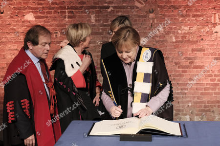 Stock Image of Rik Torfs, Angela Merkel and Anne De Paepe - Presentation of a joint honorary doctorate from KU Leuven and UGent to German Chancellor Angela Merkel for her diplomatic and political efforts, Brussels